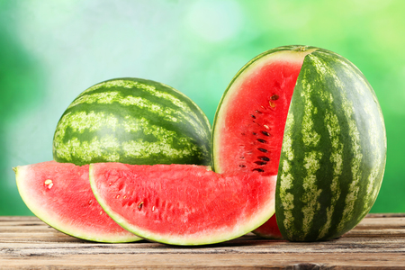 Tasty watermelon on brown wooden background Фото со стока - 45503290