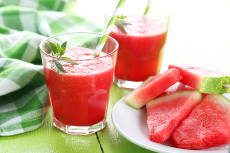 sliced watermelon: Fresh watermelon juice in the glass on wooden table Stock Photo