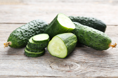 cuke: Fresh cucumbers on grey wooden background