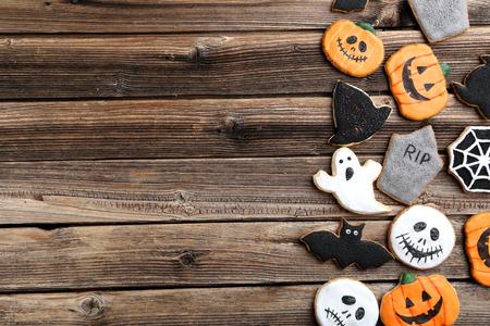 Fresh halloween gingerbread cookies on brown wooden table