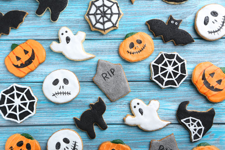 fresh halloween gingerbread cookies on blue wooden table stock photo picture and royalty free image image 45775225 - Halloween Gingerbread Cookies
