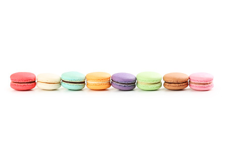 strawberry jam sandwich: French colorful macarons on white background
