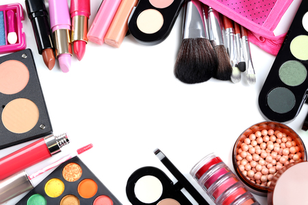 Makeup brush and cosmetics on a white background