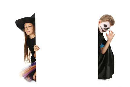 beautiful vampire: Beautiful girl witch and little boy on a white background Stock Photo