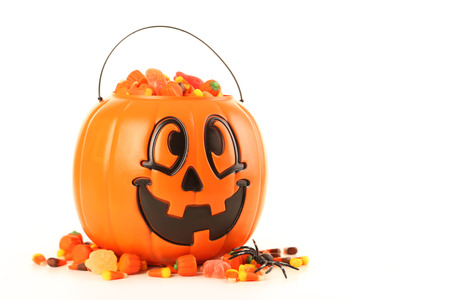 basket': Halloween pumpkin basket full of candies isolated on a white