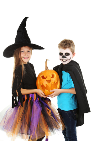 witch face: Beautiful girl witch and little boy with pumpkin on a white background Stock Photo