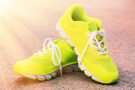 Pair of sport shoes outdoors. Toning