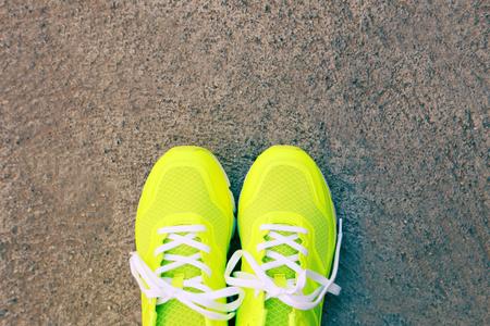 ourdoor: Pair of sport shoes outdoors. Toning