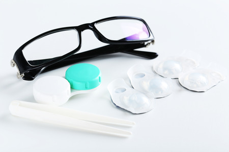 diopter: Contact lenses in container with solution on white background