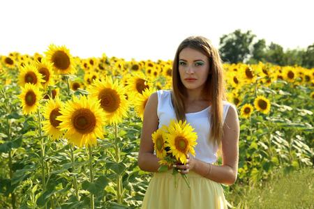 beatiful: Beatiful girl in the sunflowers field
