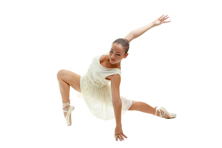 pointe shoes: Young gymnasts in pointe shoes on a white background Stock Photo