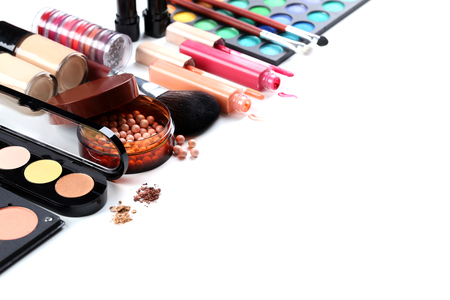 of cosmetics: Makeup brush and cosmetics on a white background