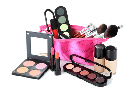 Makeup brush and cosmetics isolated on a white Stockfoto