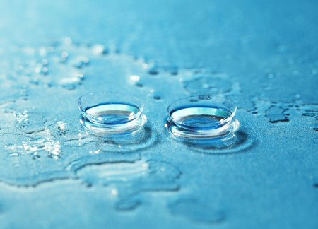 contact: Contact Lens on the blue background Stock Photo