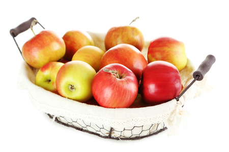 basket: Fresh apples in basket isolated on a white