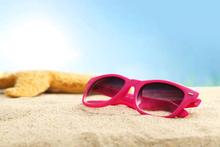glasses in the sand: Sunglasses on a beach sand