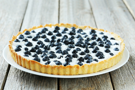 sweet tart: Sweet tart cake with blueberries on grey wooden background