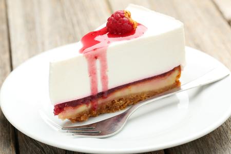 Fresh raspberry cheesecake on white plate