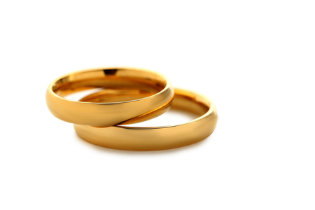 diamond rings: Golden wedding rings isolated on a white