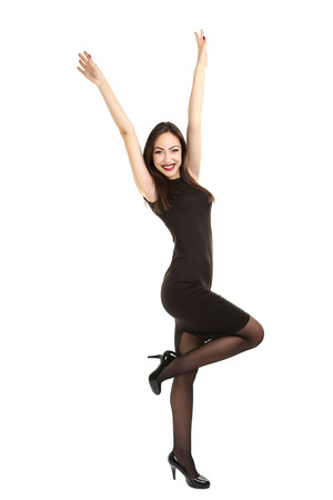 woman hands up: Young brunette woman in black dress on a white background Stock Photo