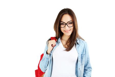 ni�a pensando: Retrato de una joven estudiante en un fondo blanco Foto de archivo