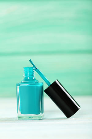 cosmetic lacquer: Bottle of nail polish on a wooden table