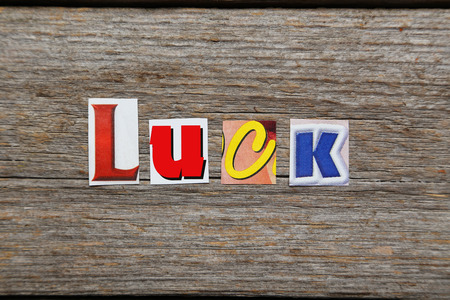 unplanned: The word Luck in cut out magazine letters