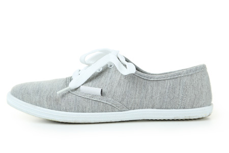 athletic wear: Grey shoes isolated on white Stock Photo