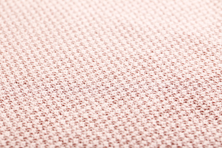 plain stitch: Knitted woolen fabric background, close up