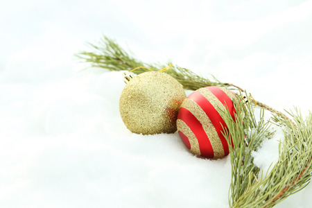 firtree: Christmas baubles with fir-tree branch on the white snow Stock Photo
