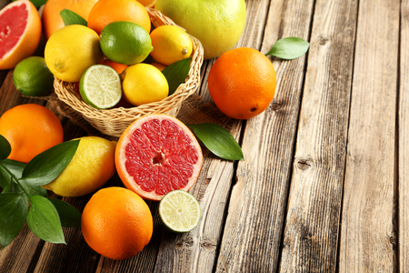 Citrus fruits on a brown wooden table Stock Photo