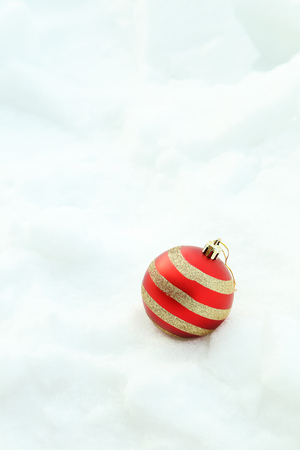 red christmas ball: Christmas baubles on the white snow Stock Photo