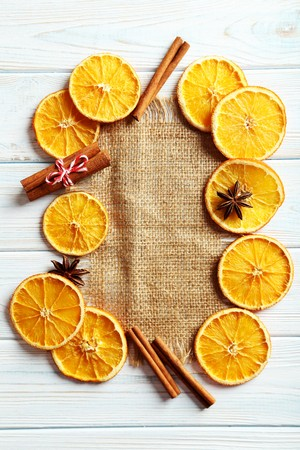 dried orange: Dried orange slices on a wooden table Stock Photo