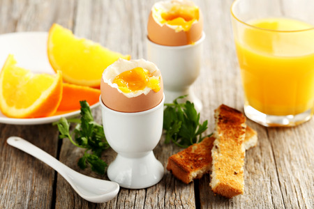 toast: Boiled egg with toasts on a grey wooden table