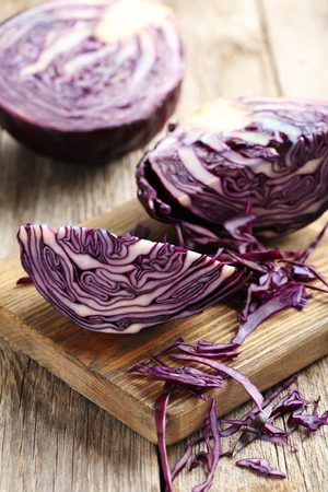 Ripe red cabbage on a grey wooden table