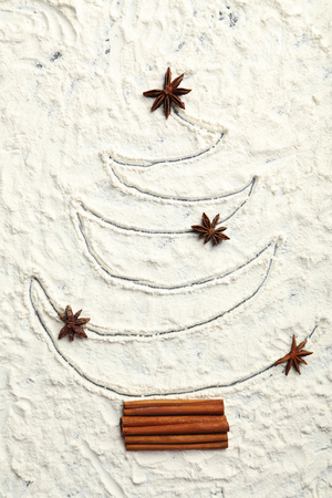 firtree: Christmas fir-tree from flour on a wooden table Stock Photo