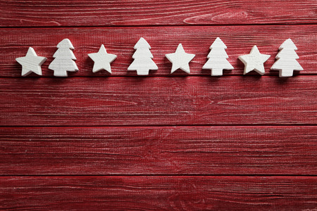 firtree: Decorative stars and fir-tree on a red wooden background
