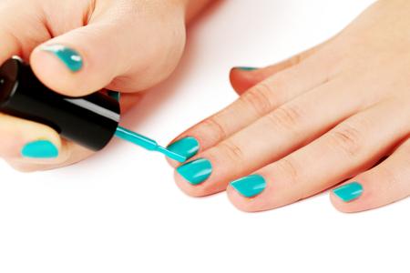 nailpolish: Nail polish in the woman hand on a white background