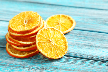 dried orange: Dried orange slices on a blue wooden table