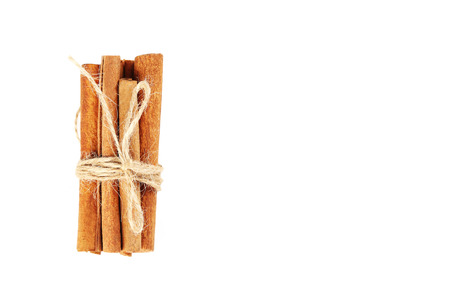stick of cinnamon: Cinnamon isolated on a white background