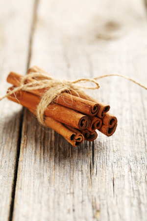 stick of cinnamon: Cinnamon on a grey wooden background Stock Photo