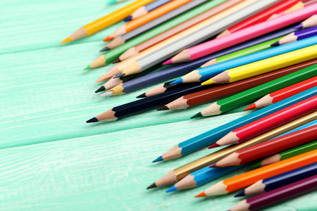 yellow art: Drawing colourful pencils on a wooden background Stock Photo