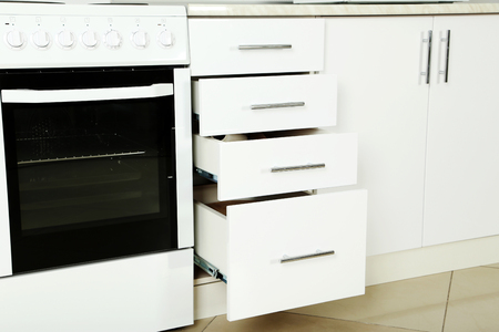bakeoven: Electric stove  with boxes in the kitchen, close up
