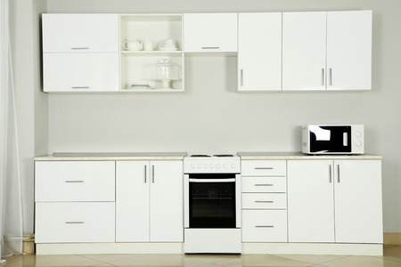 kitchen equipment: The new white kitchen interior, close up
