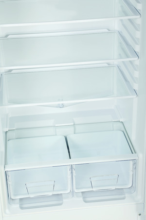 shelf ice: The open fridge with the shelves, close up
