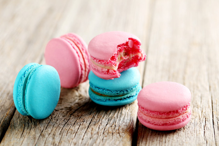 strawberry jam sandwich: Tasty french macarons on a grey wooden table