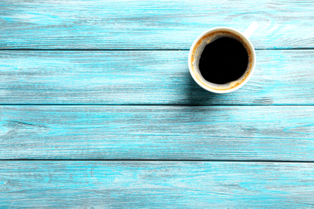 coffee foam: Cup of coffee on a blue wooden table Stock Photo