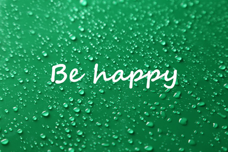 be wet: Be happy - Water drops on green background