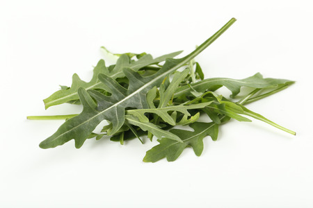 rukola: Fresh arugula leafs isolated on a white Stock Photo