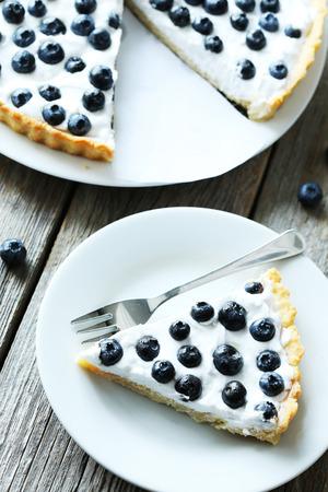 sweet tart: Sweet tart cake with blueberries on grey wooden background